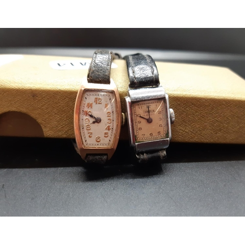 25 - Two Art Deco ladies wristwatches, one hallmarked 9ct gold with black leather strap and marked B.W.C ...