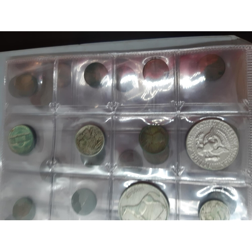 33 - A collection of coins, stamps and books to include one coin album containing Belgian, Swiss, French,...