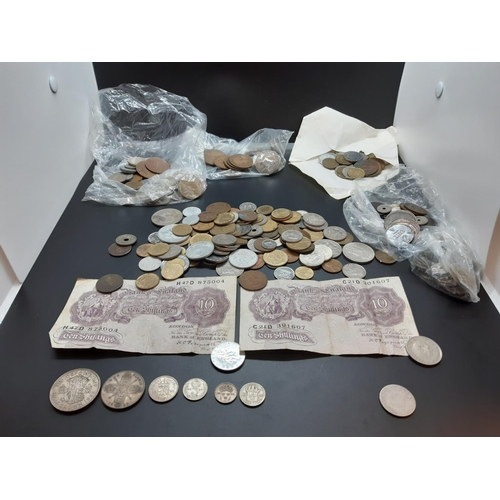 33A - A very varied collection of coins and banknotes of the world to include 50% silver 1942 half crown, ...