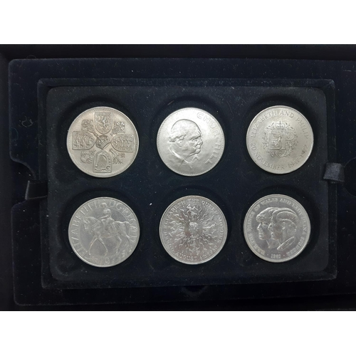 34 - Six commemorative Elizabeth II coins in Westminster collectors display case...