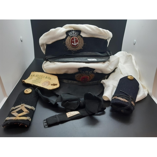 43 - Two WWII Period Royal Navy caps with epaulettes to include one P.R.D Ltd of Hull and one S.W. Silver...