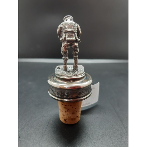 5 - A white metal golfing figural wine stopper - approx. 8cm with stopper...