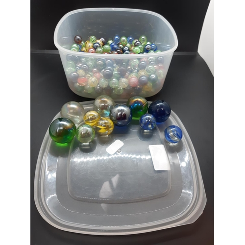 53 - A box containing a large quantity of marbles...