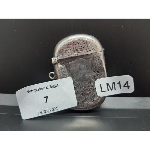 7 - A hallmarked Birmingham silver vesta case dated 1912 by T. Heatley - approx. 14.72 grams and 5.5cm h...