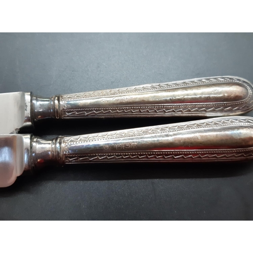 8 - Two boxes containing cutlery to include five hallmarked Sheffield silver handled butter knives and a...