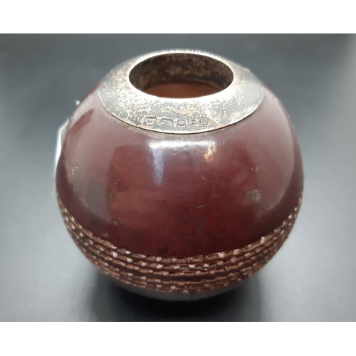 9 - A late 19th century Doulton Lambeth Silicon Ware cricket ball match holder/striker with hallmarked C...