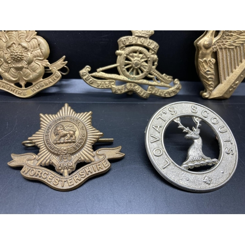 2 - Five various cap badges to include Lancashire Hussars, Worcestershire, Lovat Scouts, Royal Irish Reg...