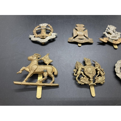 3 - Six various cap badges to include Hampshire Regiment, Middlesex Regiment, Wiltshire Regiment, West R...