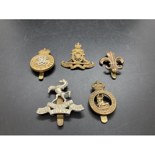 4 - Five various cap badges to include Royal Artillery, Royal West Kent Regiment, Queens Own Hussars, He...