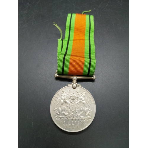 11 - Three WWII medals to include Italian Star, 1939-1945 Defence Medal and 1939-1945 War Medal