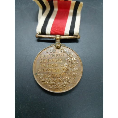 14 - Two items, one George V Faithful Service Special Constabulary Medal awarded to Reuben Wilson and one...