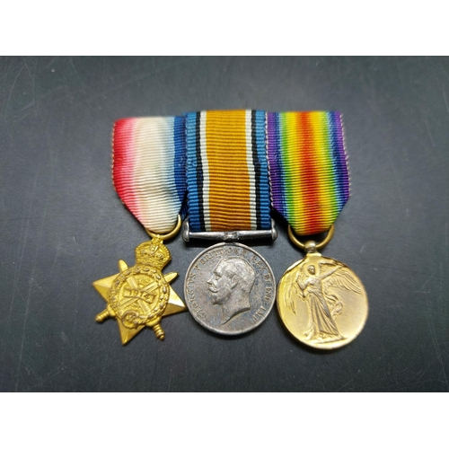 16 - A WWI British miniature medal trio comprising 1914 Star, British War Medal and Victory Medal mounted...
