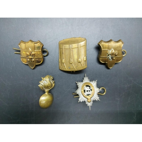7 - A collection of shoulder and collar badges