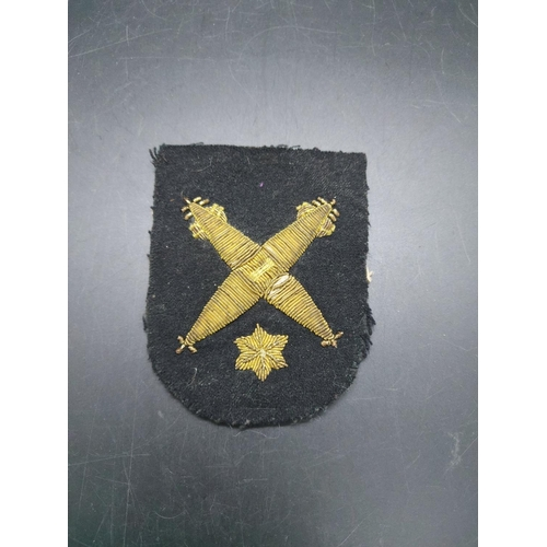 8 - A collection of Royal Navy cloth rank and service bar badges