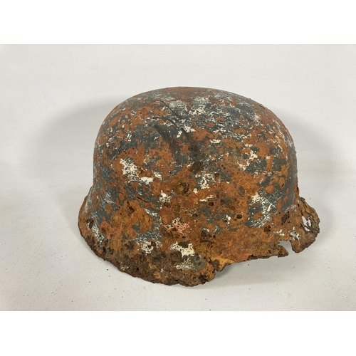33 - A WWII German relic helmet found on the Eastern Front with white painted camouflage