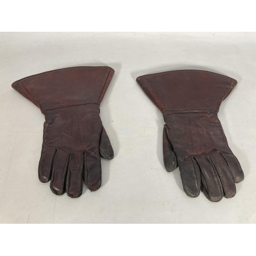 38 - Two items, one WWII British Army leather jerkin dated 1943 and one pair of leather gauntlets