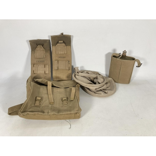 43 - Three canvas and webbing military items to include one British water canteen