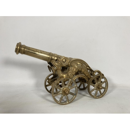 49 - A vintage Chinese dragon cannon on four wheel base - approx. 24cm high x 17cm wide x 42cm deep