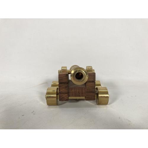 50 - An ornamental brass cannon - approx. 9cm high x 13.5cm wide x 17cm deep