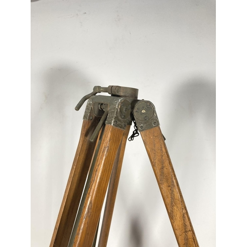 52 - An oak and green metal military tripod - approx. 85cm high