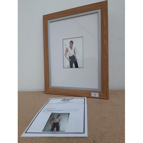 1004 - A framed Michael Jackson colour photograph signed by Michael Jackson with certificate of authenticit...