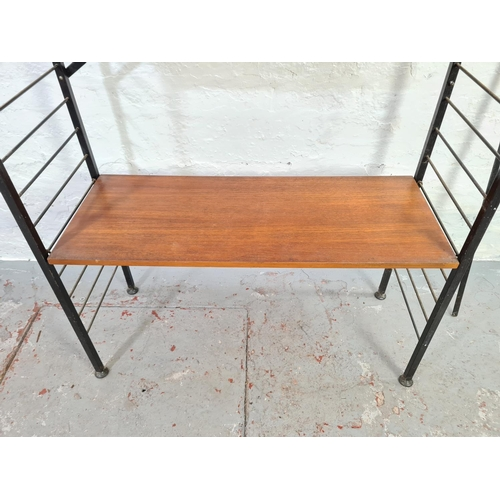687 - A 1960s Staples Ladderax teak and black metal free standing four tier shelving unit - approx. 201cm ...