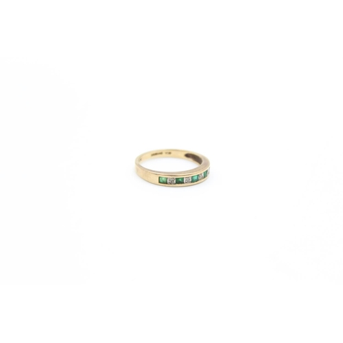 51 - A 9ct gold emerald & diamond half eternity ring, size L - approx. gross weight 1.8 grams