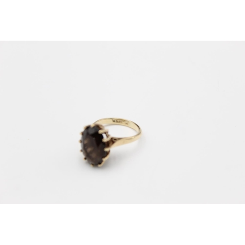 3 - A 9ct gold smoky quartz set dress ring, size J - approx. gross weight 3.3 grams