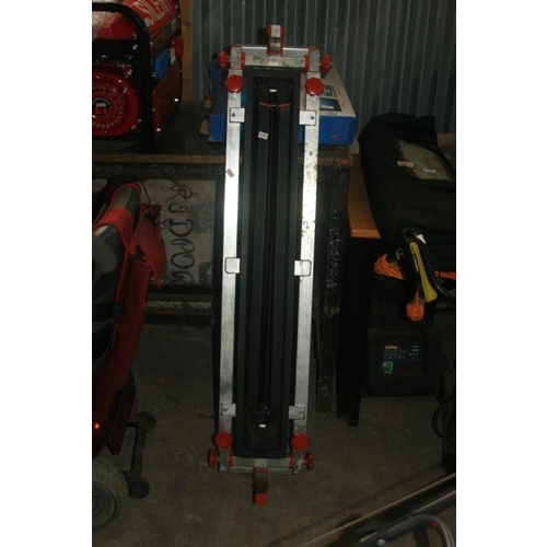 24 - FOLDING SAW STAND WITH ROLLERS...