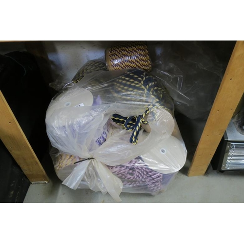 23 - LARGE BAGS OF EDGING/TIE BACK MATERIAL...