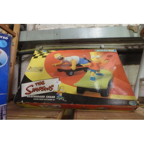 23 - BOXED SCALEXTRIC 'THE SIMPSONS' SLOT RACING GAME