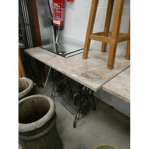 """Marble topped cast iron based table (30"""" h x 45.5"""" l x 26"""" w)"""