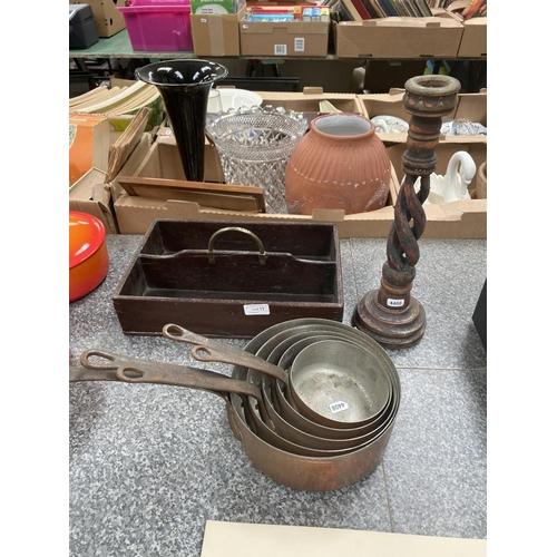 11 - 5 Copper beaten graduated pans, barley twist candlestick & oak cutlery tray