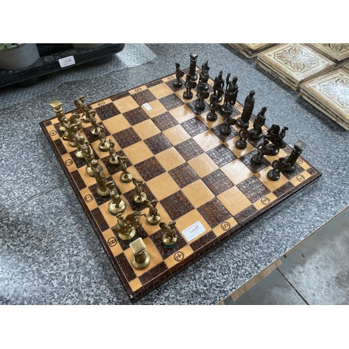 27 - Cast metal chess set on wooden board