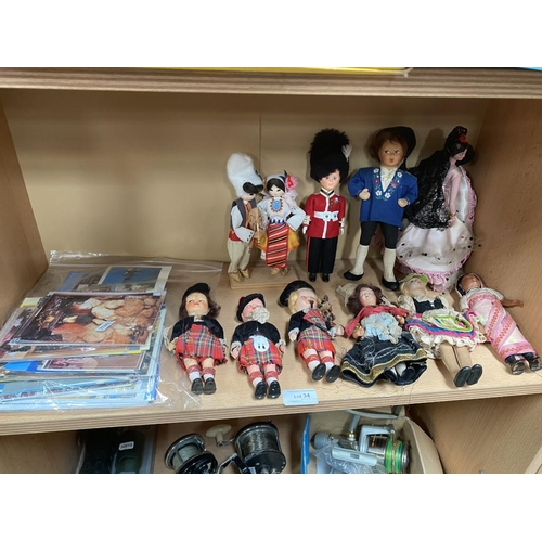 34 - Collection of postcards & collection of world dolls