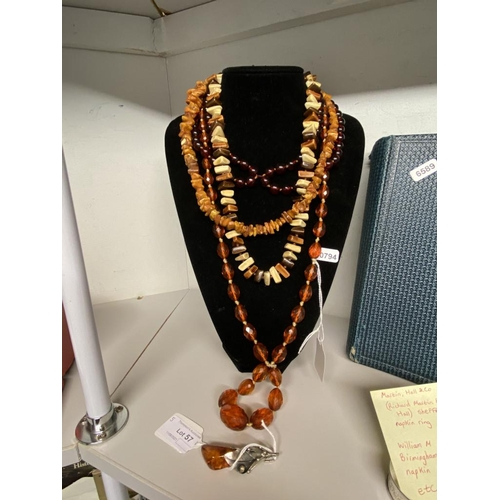 57 - Silver pendant & 3 amber style necklaces & 1 other