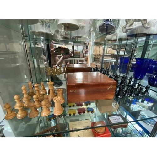 Mahogany box containing set of chess pieces