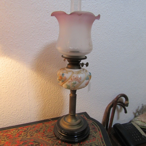 12 - Victorian Oil Lamp on Brass Chased Column with Ornately Decorated Bowl Approximately 19 Inches High...