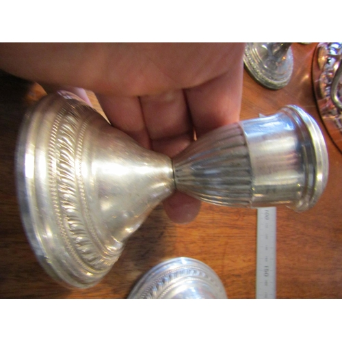 31 - Pair of Solid Silver Turned Column Candle Rests on Circular Stepped Bases Each Approximately 5 Inche...