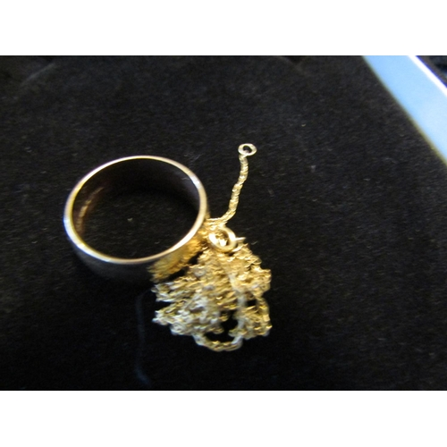 5 - 9 Carat Gold Wedding Band and 9 Carat Gold Chain...