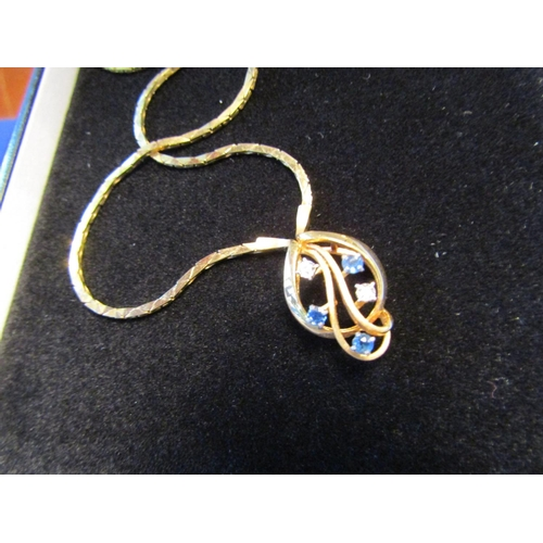 52 - Ceylon Sapphire and Diamond Decorated Entwined Leaf Motif Ladies Pendant Necklace 9 Carat Gold Mount...