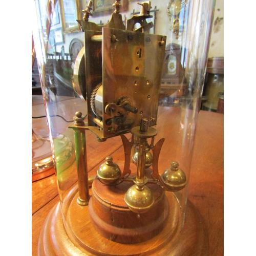 58 - Brassbound Gravity Clock with Original Keys Glazed Under Dome Approximately 14 Inches High...
