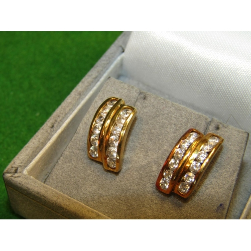 20 - Pair of Diamond Twin Row Earrings of High Colour Set in 18 Carat Gold...