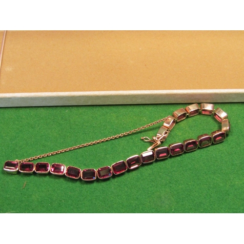 25 - 9 Carat Gold Garnet Mounted Articulated Form Ladies Bracelet of Good Form Colour and Weight...