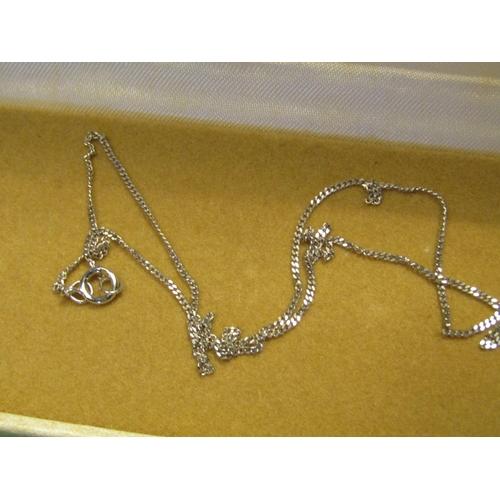 32 - 9 Carat White Gold Diamond Set Ladies Pendant Necklace of Modernist Form...
