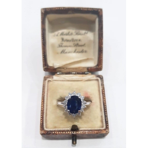 364 - Sapphire and Diamond Oval Cluster Ring Mounted on 18 Carat White Gold with Central Sapphire Approxim...
