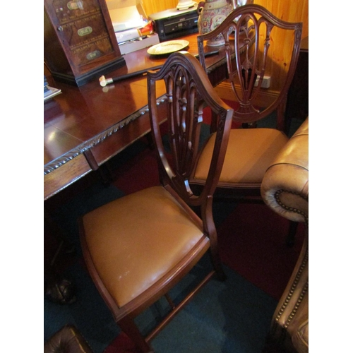 Antique Set of Six Hepplewhite Shield Back Mahogany Chairs with Tan Leather Seats above Well Carved Supports