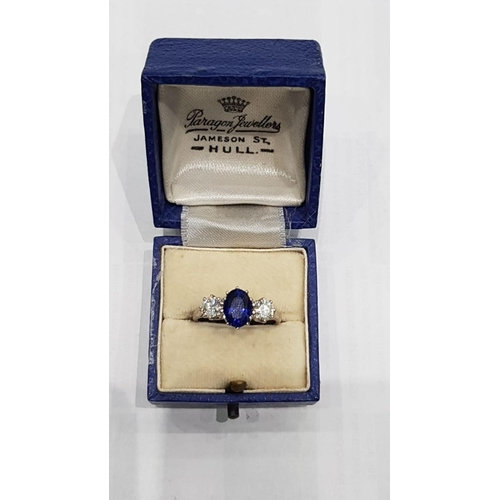 101 - Three Stone Sapphire and Diamond 18 Carat White Gold Ring Oval Cut Central Sapphire with Two Brillia...