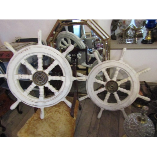 Two Painted Timber Ships Wheels with Brass Central Fittings Largest Approximately 22 Inches Diameter