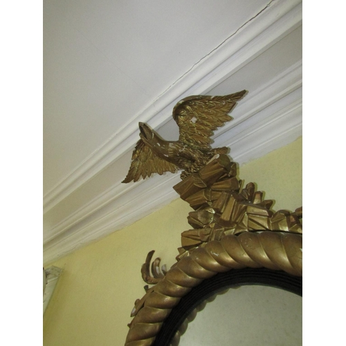 412 - Irish Regency Carved Giltwood Convex Mirror of Generous Form with Upper Carved Eagle Decoration Appr...